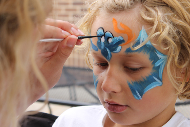 Neo Kok gets his face painted by Danielle Ward at Saline's Summerfest.